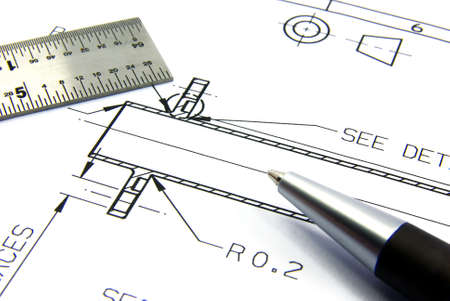 Detail view of a technical drawing with pen and ruler.