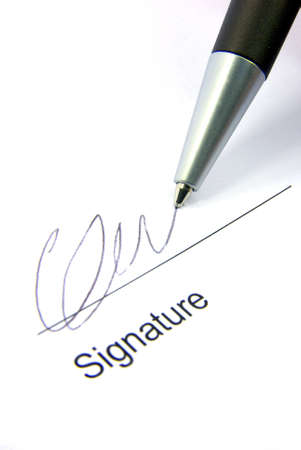 Detail view of the signature box of a contract with a pen. photo