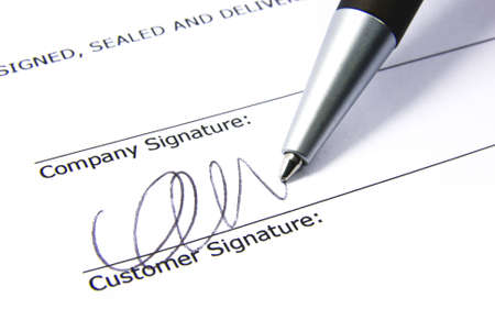 Detail view of the signature box of a contract. photo