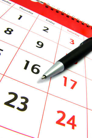 Detail view of a typical calendar with a pen. Stock Photo