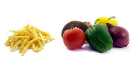 View of some chips and vegetables over white background. photo