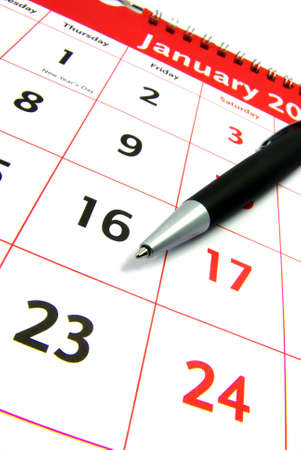 scheduled: Detail view of a typical calendar with a pen. Stock Photo