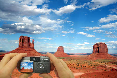 Illustration of a tourist taking a shot of Monument Valley. illustration