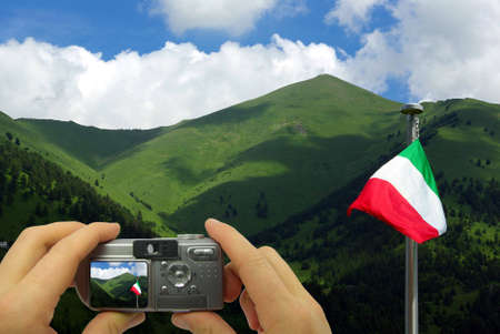Photo montage of a tourist taking a photo of the mountains in Italy. photo
