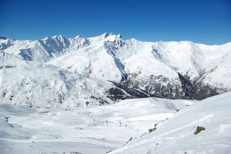 Landscape of snowy mountains in the Alps. photo