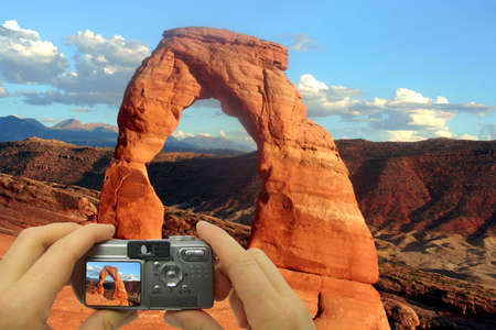 Illustration of a tourist taking a shot of Delcate Arch. illustration