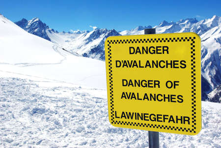View of a notice board showing a danger of avalanches.