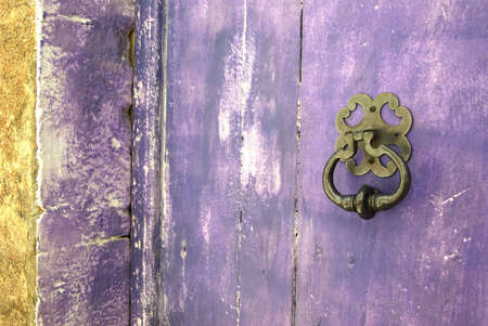 Detail view of a colorful front door.