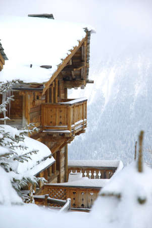 View of a luxurious log cabin in the Alps in France.