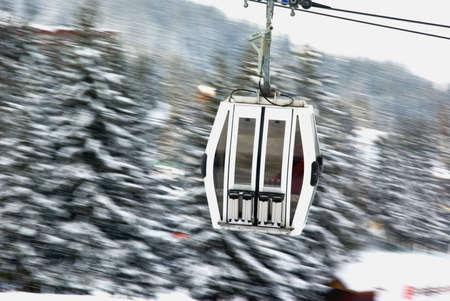 Enclosed ski gondola in motion. photo