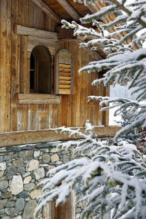Detail of a log cabin in a skiing resort. Stock Photo