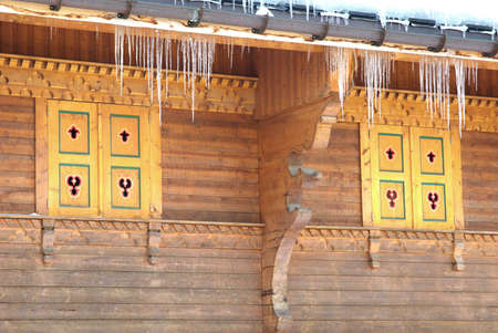 iciness: View of some icicles on a decorated chalet. Stock Photo
