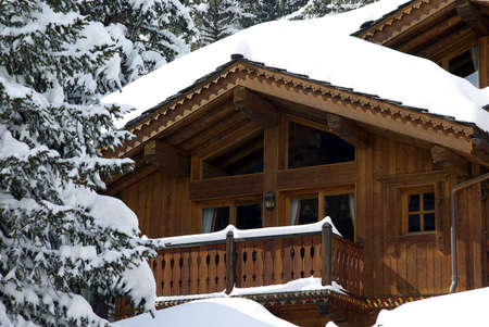 Detail view of a luxurious log cabin in the Alps in France. Stock Photo