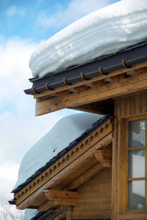 Detail of a chalet roof covered of snow. Stock Photo - 4477264