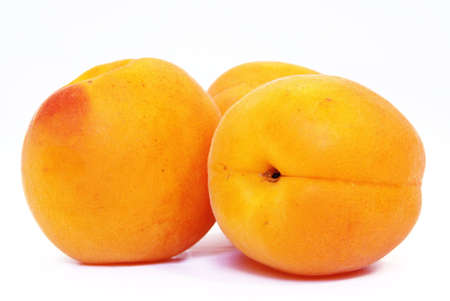 Studio shot of some nice fresh apricots. photo