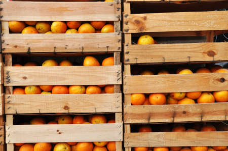 Image of wooden crates full of oranges. Stock Photo