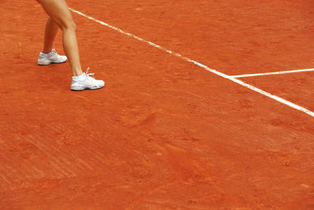 Image of a tennis court in clau with a tennis woman. photo