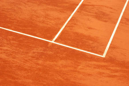 Detail view of the lines of a tennis court in clay photo