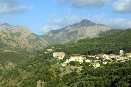 Beautiful view on a typical corsican village in the mountains. photo