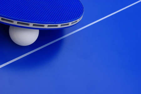 Image of a ping-pong ball with a racket on a table. photo