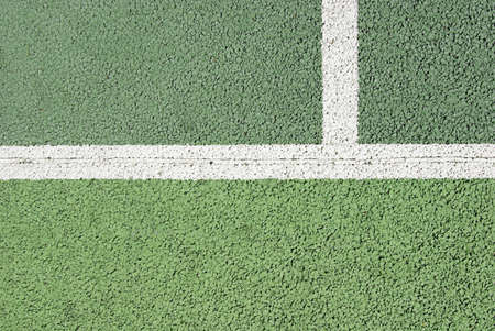 Macro shot of the lines of a tennis court in asphalt photo