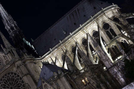 detailed image: Detailed image of Notre-Dame cathedral by night Stock Photo