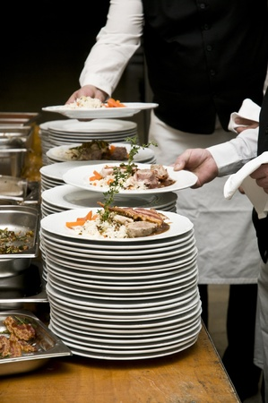 mingle: Dish serving on a party in Europe. Stock Photo