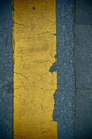 distinct: view of road with distinct yellow stripe Stock Photo