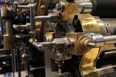 Old printing press, mechanical gears photo