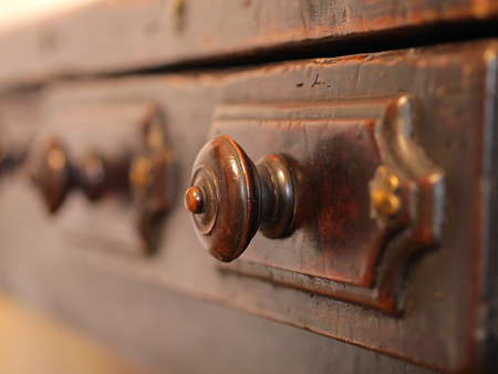 Old archive wooden drawers. Close up view of drawer Handle. Stock Photo