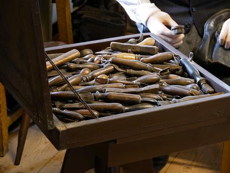 Vintage cobbler workshop with shoe making tools.