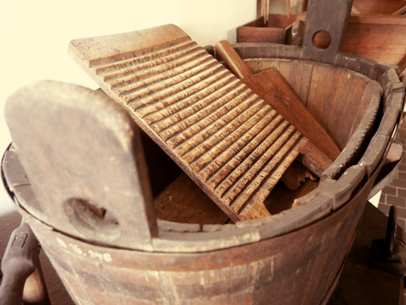 Old washing method, old wooden trough with washboard.