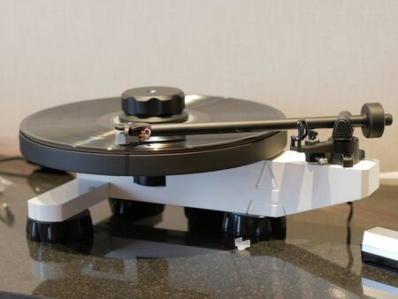 HiFi turntable with vinyl record. Audiophile analog audio equipment for luxury sound experience. Listen to the music in great quality with vintage turntables.