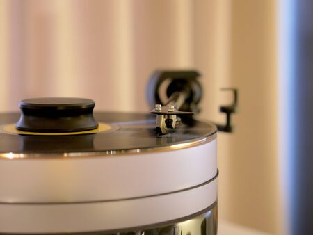 Turntable vinyl record player. Sound technology for Audiophile HiFi luxury play music. Needle on a vinyl record.