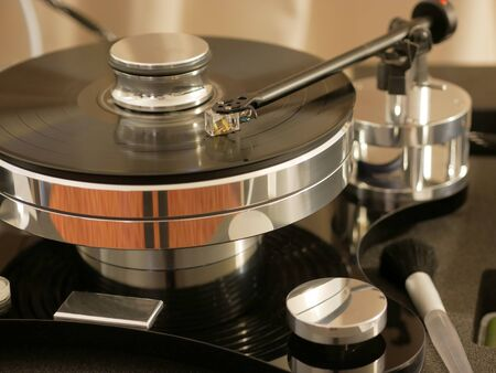 Retro turntable player.Turntables needle on vinyl record disc with music. Audiophile analog audio equipment for HiFi luxury sound system.
