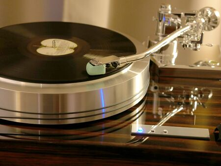 Audiophile HiFi turntable player. Wooden plinth. Retro audio equipment.