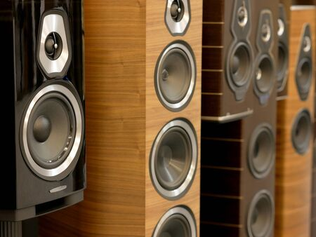 Audiophile Stereo stylish speakers. Detail view of row of pole speakers. Stock Photo