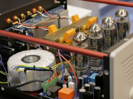 Vacuum tube amplifier with electric power supply. Stereo Audiophile equipment for faithful sound recording. Stock Photo