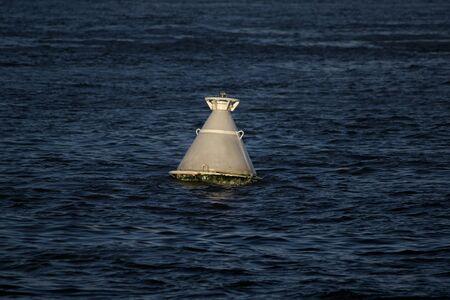 Navigation buoy at the fairway. Imagens