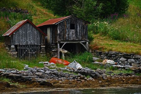 Two old boat houses in Geiranger, Norway photo