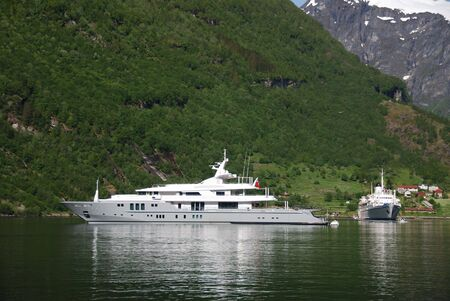 Yacht at anchor in Geiranger Stock Photo