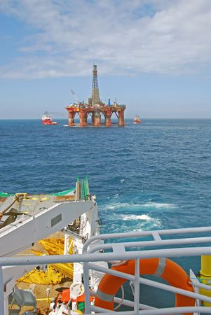 Rig move of an Semi submersible drilling rig in the North Sea. Stock Photo - 4700953
