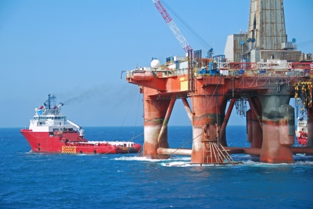 oilrig: Rig move of an Semi submersible drilling rig in the North Sea. Stock Photo