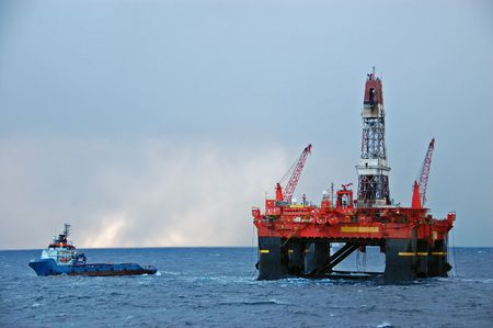 Vessel engaged in Rig move of an Oil platform in the North Sea photo