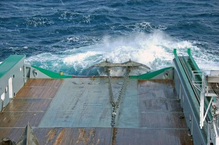 Pulling anchor on to deck of an Anchor Handling Tug Supply vessel Stock Photo - 4733915
