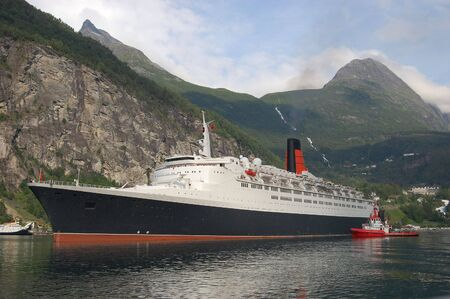 Passenger ship departing Geiranger, Norway photo