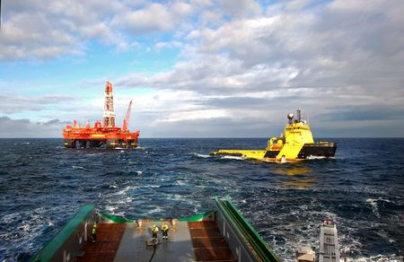 oilrig: Anchor handling of an Semi Submersible Oil Rig in the North Sea. Stock Photo