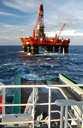barge: Anchor handling of an Semi Submersible Oil Rig in the North Sea. Stock Photo