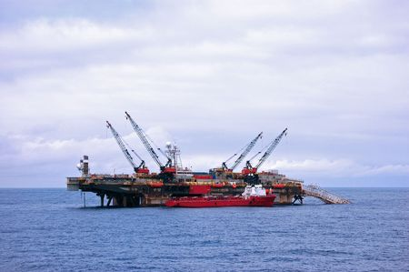 Supply vessel alongside pipe laying barge in the North Sea photo