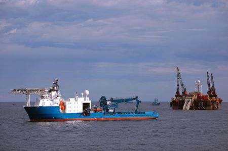 Pipelaying barge and an Underwater construction vessel operating in North Sea Stock Photo - 5714865